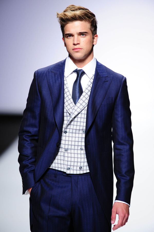 Barcelona, Spain. 9th May 2014 -- The model River Viiperi, boyfriend from Paris Hilton, parading with a Fuentecapala new collection suit during the Fuentecapala exhibition on the fourth day of Barcelona Bridal Week 2014, in Barcelona. -- The Spanish groom suits brand Fuentecapala exhibit in the fourth day of the Barcelona Bridal Week 2014 it's new 2014 collection., Image: 193610127, License: Rights-managed, Restrictions: , Model Release: no, Credit line: Profimedia, Corbis